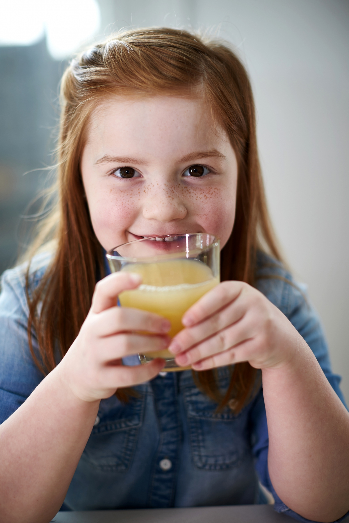 Girl drinking apple juice
