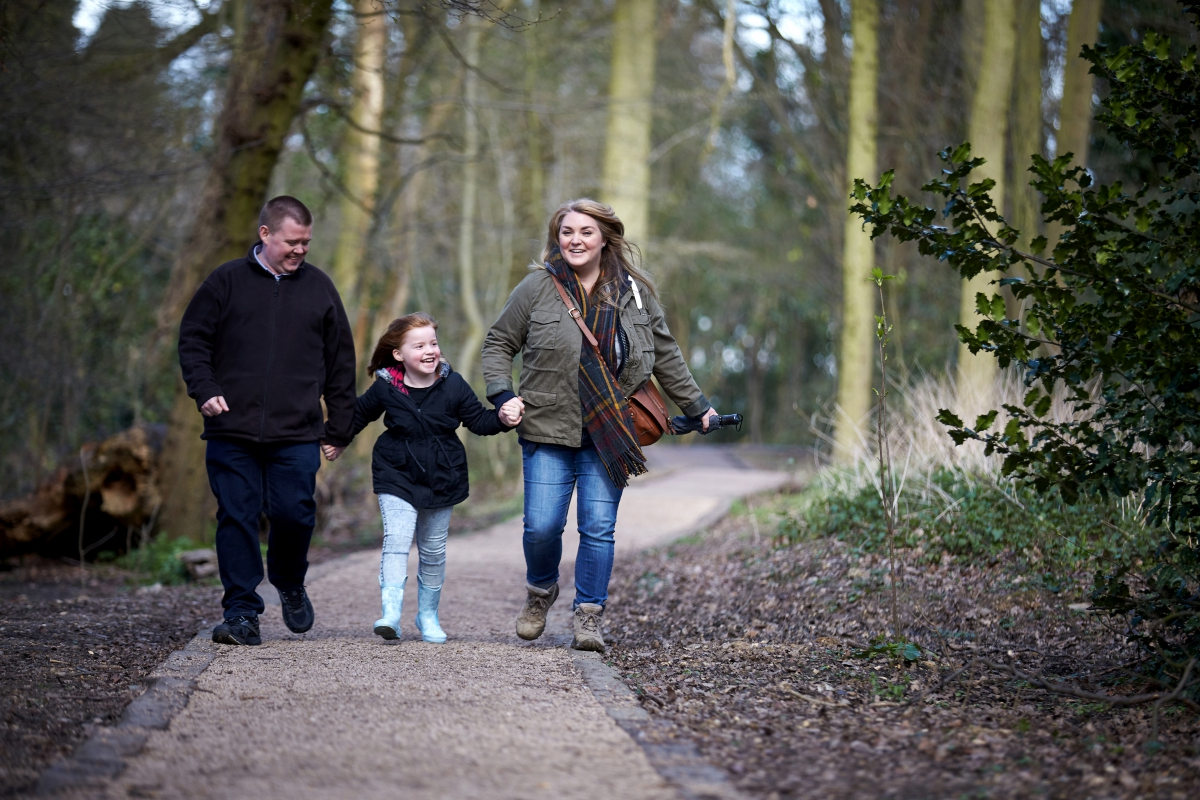 Smiling family walking in the woods