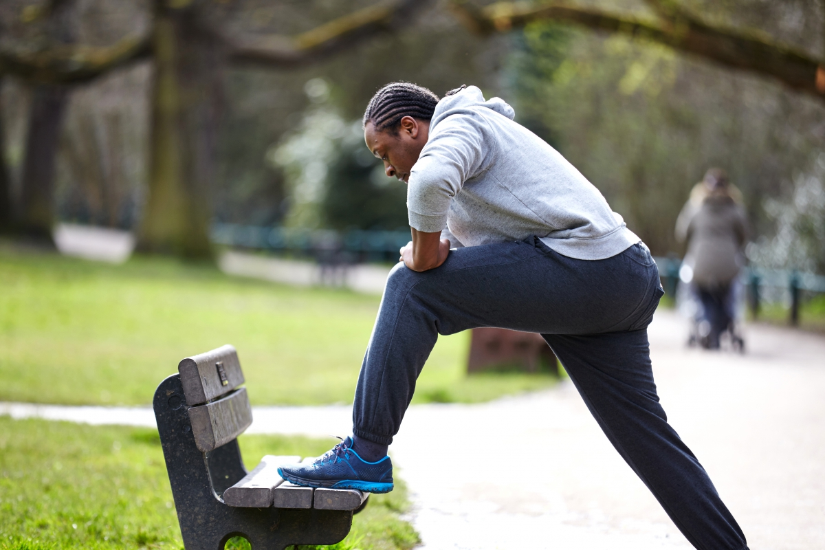 Man stretching after a run in the park