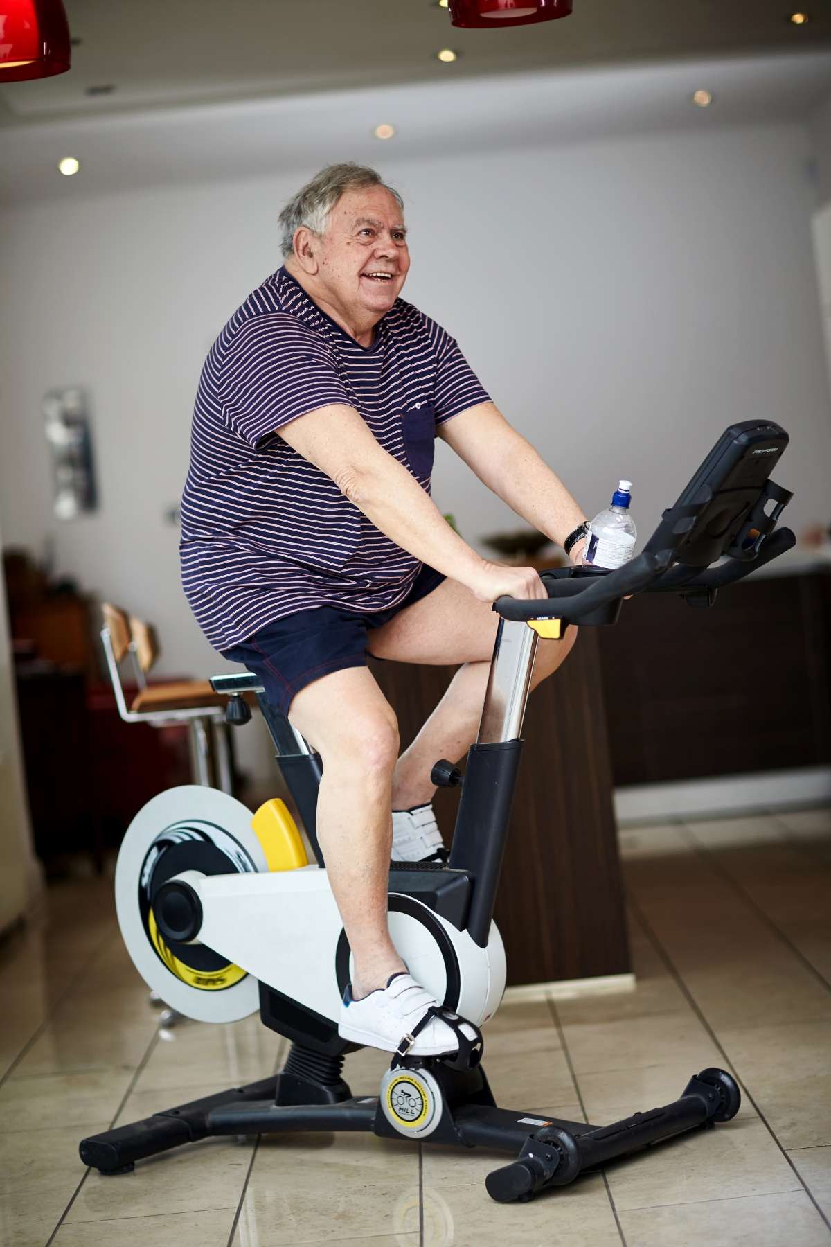 Older man working out on exercise bike