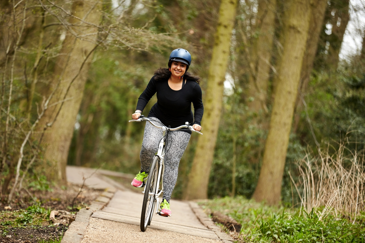 Woman riding her bike in the woods
