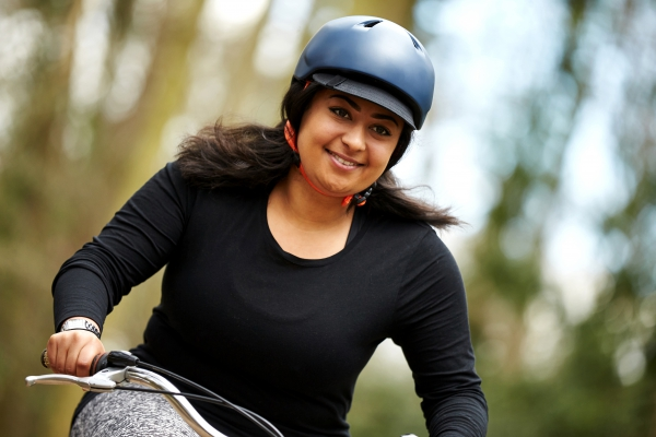 Woman on bike wearing helmet