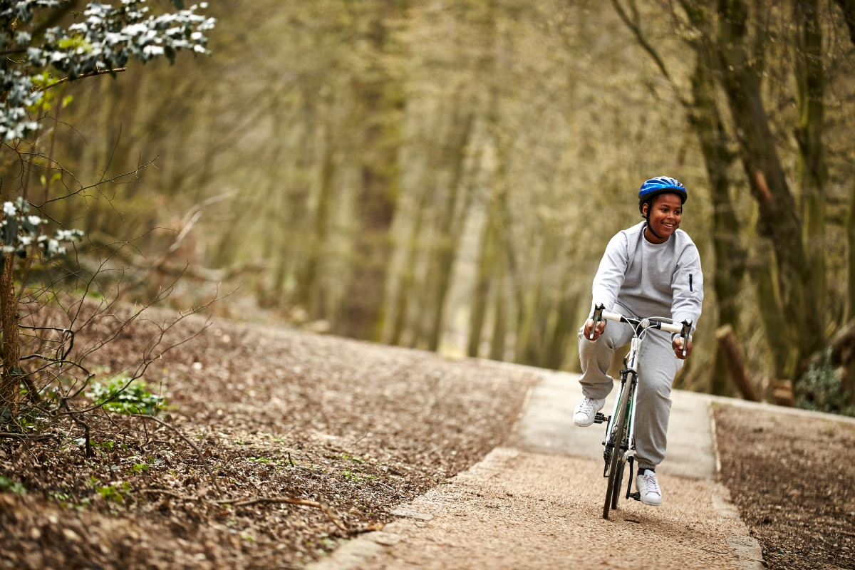 Teenage boy cycling in the woods