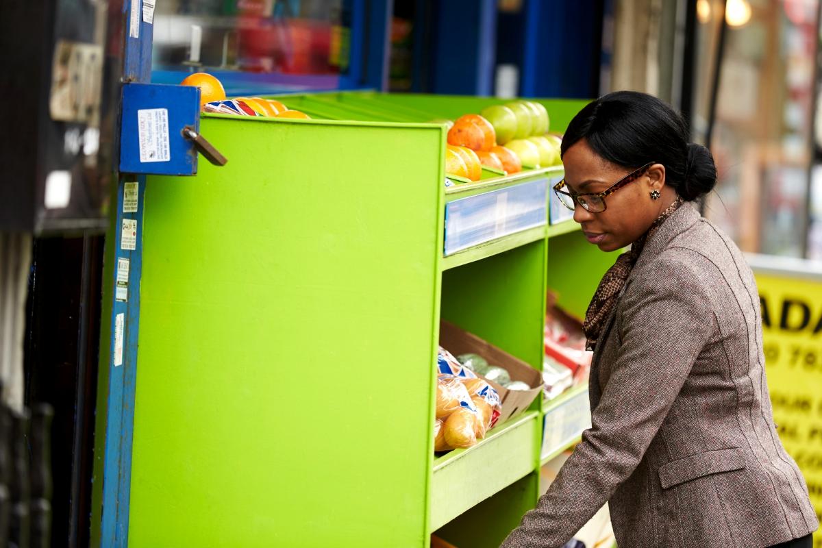 Business woman sees fruit outside shop