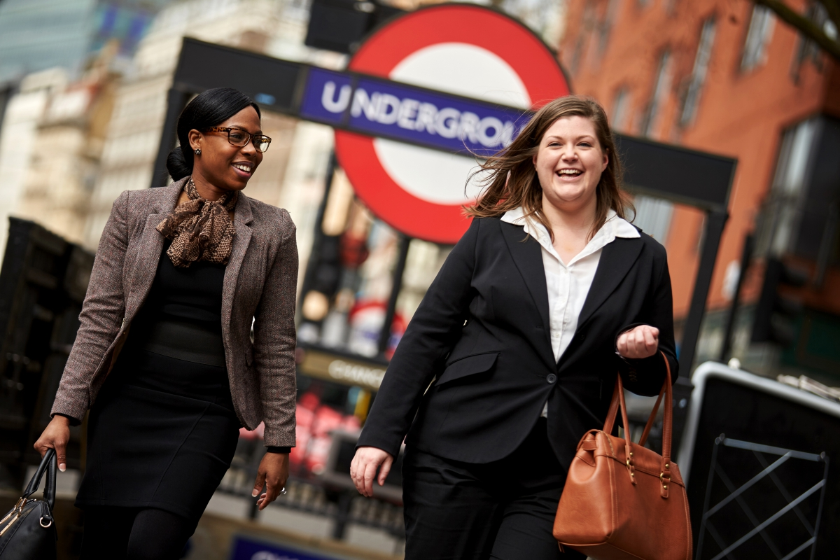 Two business women exiting underground