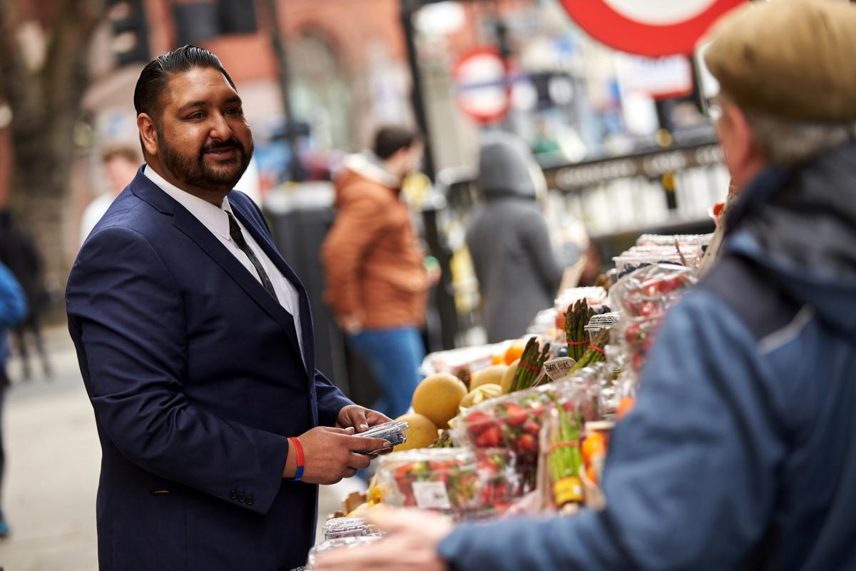 Man at food stall, browsing its wares