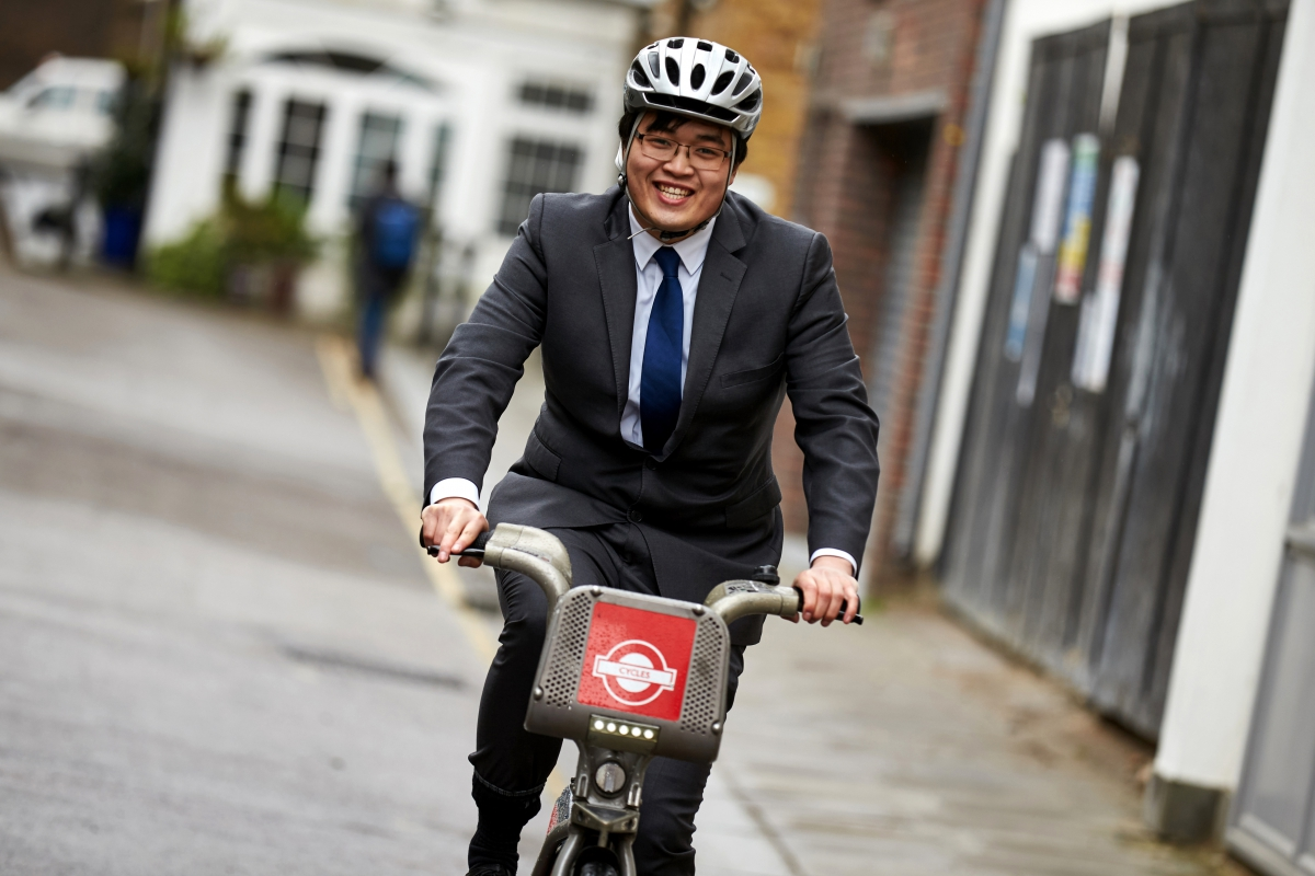 Business man cycling to work