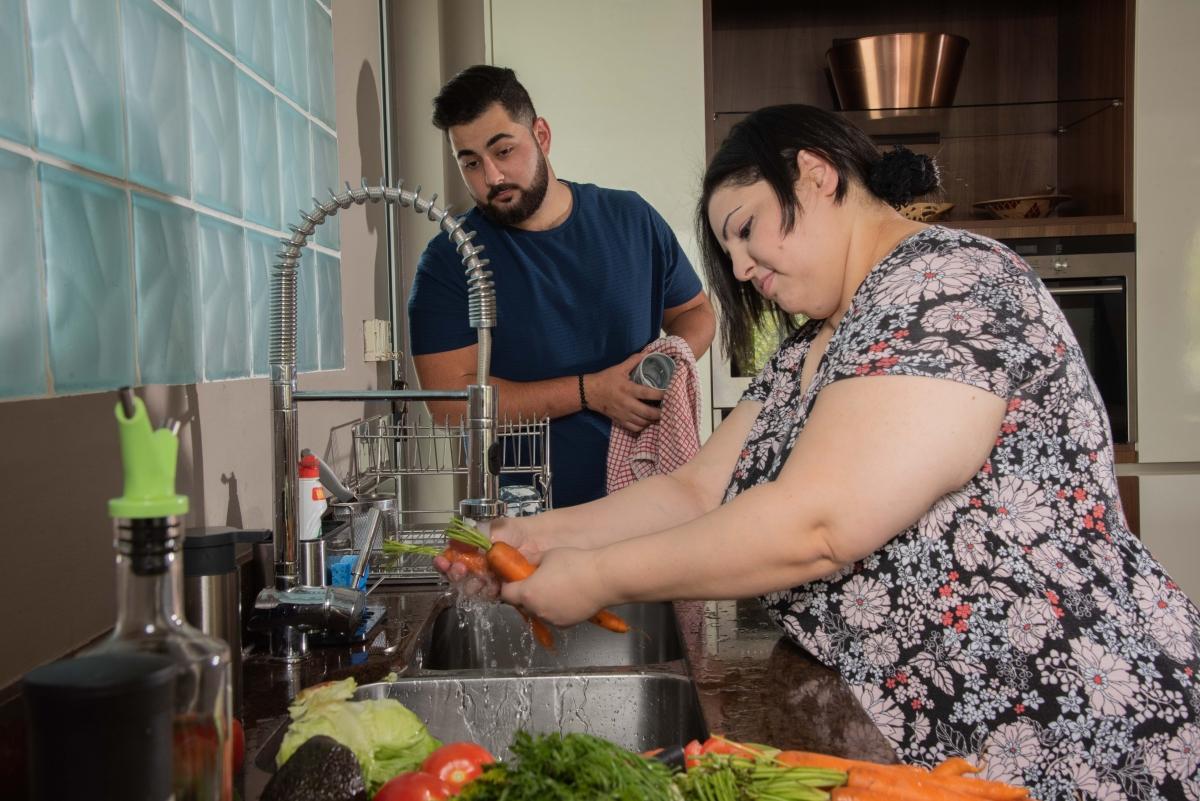 Woman and man preparing dinner 2